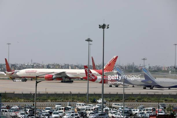 An Air India Ltd aircraft stand on the tarmac at the Indira Gandhi International Airport in New Delhi India on Friday May 8 2020 India is deploying...