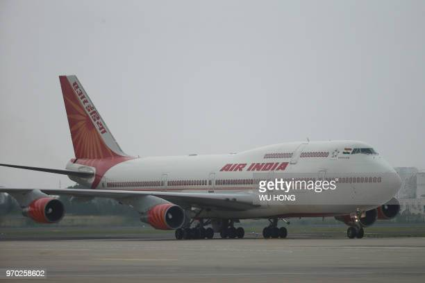 An Air India plane carrying Indian Prime Minister Narendra Modi arrives at Qingdao Liuting International Airport for the 18th Shanghai Cooperation...