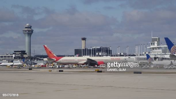 An Air India plane parks at the gate at Chicago O'Hare International Airport on March 7 2018 / AFP PHOTO / Daniel SLIM