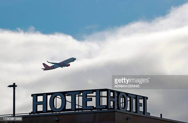 An Air Malta aircraft is pictured as it takes off from behind the Sofitel hotel at Terminal 5 of London Heathrow Airport in west London on February...