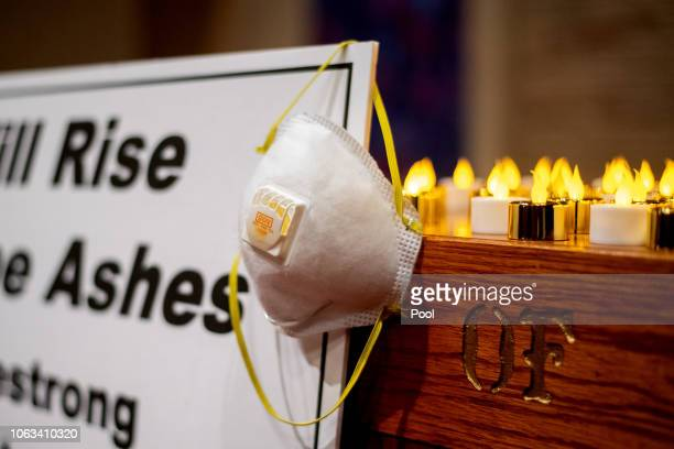 An air mask hangs on an altar during a vigil for Camp Fire victims at the First Christian Church of Chico on November 18 2018 in Chico California The...