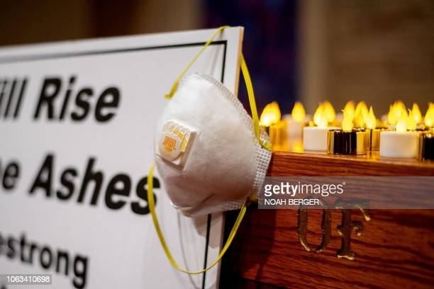 An air mask hangs on an altar during a vigil for Camp Fire victims on Sunday November 18 2018 at the First Christian Church of Chico in Chico...