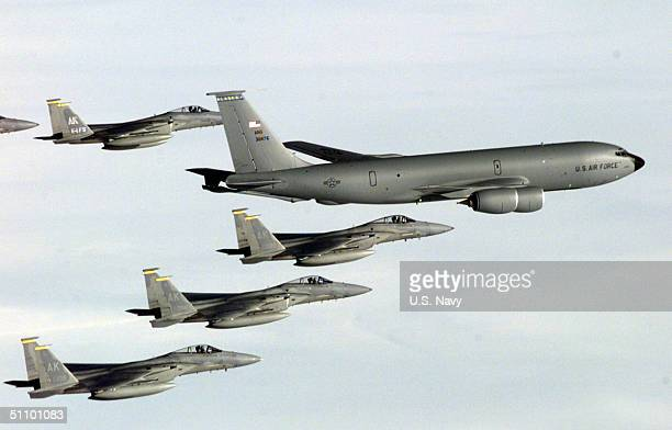 An Air National Guard Kc135R Stratotanker Provides Enroute Refueling Support To Six F15C Eagles On 14 April 1999 The F15S Are Being Deployed In...