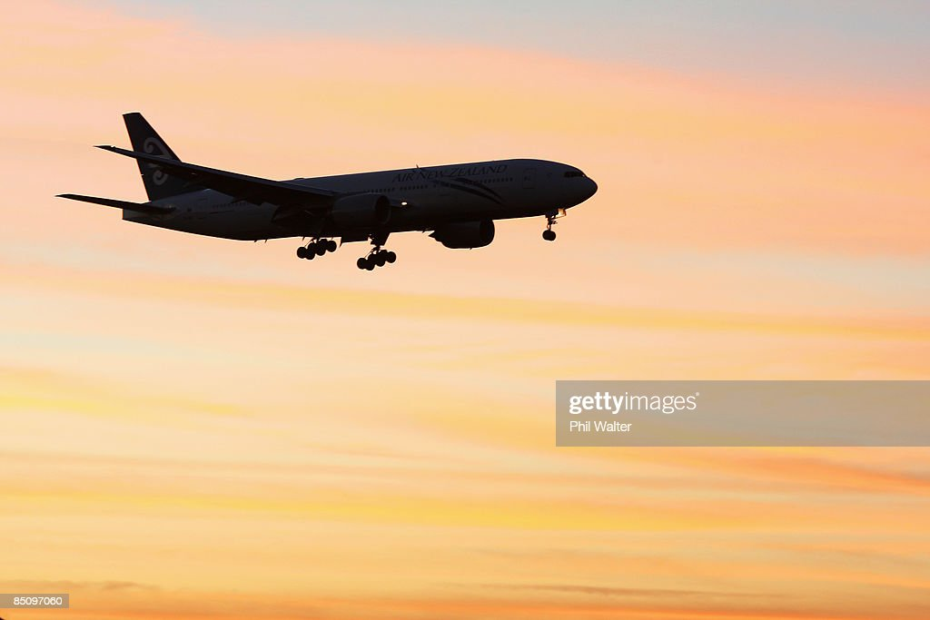 An Air New Zealand jet comes into land at Auckland International Airport at dawn on February 26, 2009 in Auckland, New Zealand. Air New Zealand today announced their half year earnings which have dropped 84 percent to $26 million for the six-month period to the end of 2008.