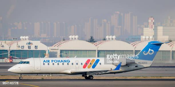 An Air Pohang Bombardier CRJ200 taxis down the runway at Gimpo International Airport on 17 April 2018 in Seoul South Korea Korea's budget carriers...