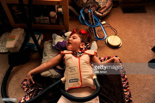 September 10: An air pulse generator that rapidly fills and deflates a vest helps Haleigh breathe. Her cheeks and most of her body shake and bounce...