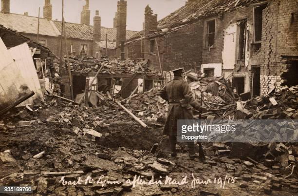 An Air Raid Warden examining properties damaged by an air raid in Kings Lynn England during World War One circa January 1915
