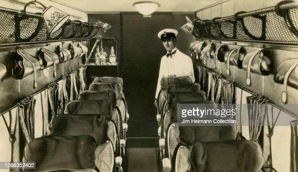 An air steward awaits passengers to board an empty plane, circa 1929.