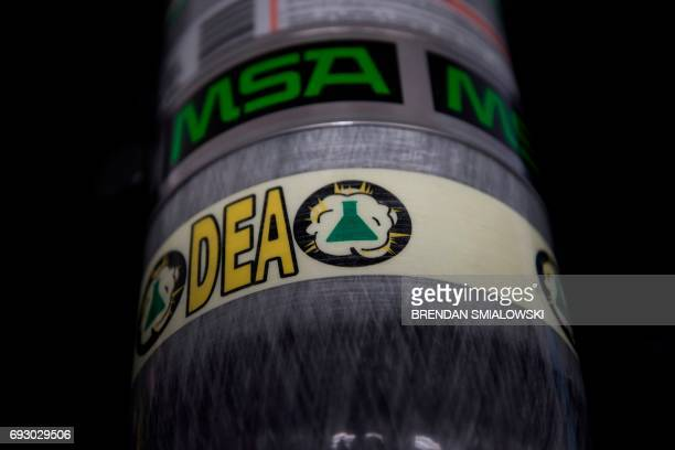An air tank is seen before a press conference about fentanyl at the headquarters of the Drug Enforcement Agency June 6 2017 in Arlington Virginia The...