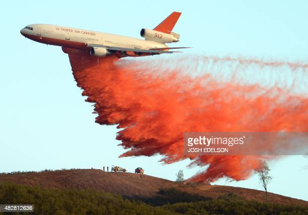 An air tanker drops fire retardant along a ridge to help contain the Rocky fire near Clearlake California on August 2 2015 Thousands of firefighters...