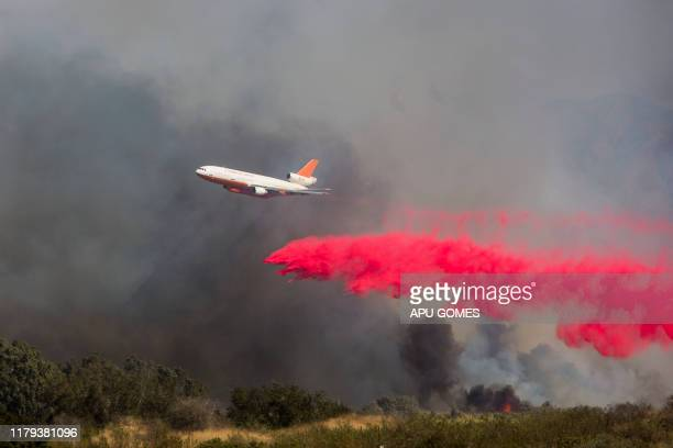 An Air Tanker drops fire retardant over lines while helping to fight the Maria fire in Santa Paula Ventura County in California on November 01 2019