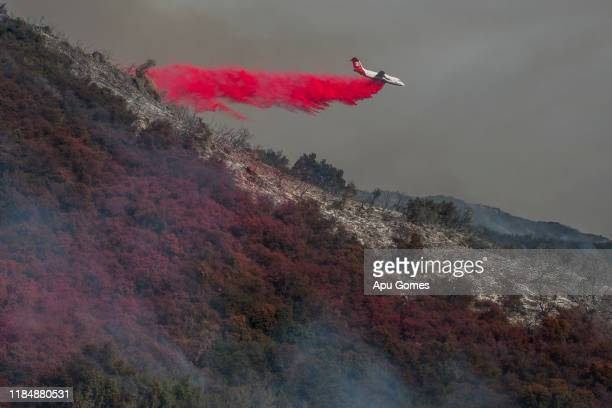 An air tanker drops fire retardant over the Cave Fire on November 26 2019 in Santa Barbara California Officials say the fire is now 10 percent...