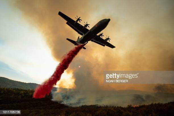 TOPSHOT An air tanker drops retardant on the Ranch Fire part of the Mendocino Complex Fire burning along High Valley Rd near Clearlake Oaks...