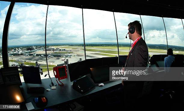 An air traffic controller looks out towards the runway as he works inside the new control tower at Manchester Airport operated by Manchester Airports...