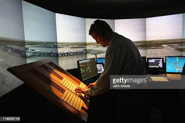 An air traffic controller works inside an airport tower simulator on July 14 2011 at the Denver International Airport in Denver Colorado The Federal...