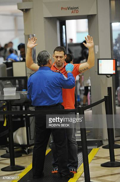 An air traveler is patted down after passing through a fullbody scanner at the Transportation Security Administration security checkpoint at Los...