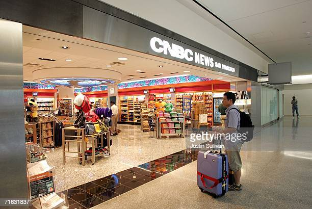An air traveller stands in front of a CNBC News store which sells, among other things, bottled drinks, in the international terminal at San Francisco...