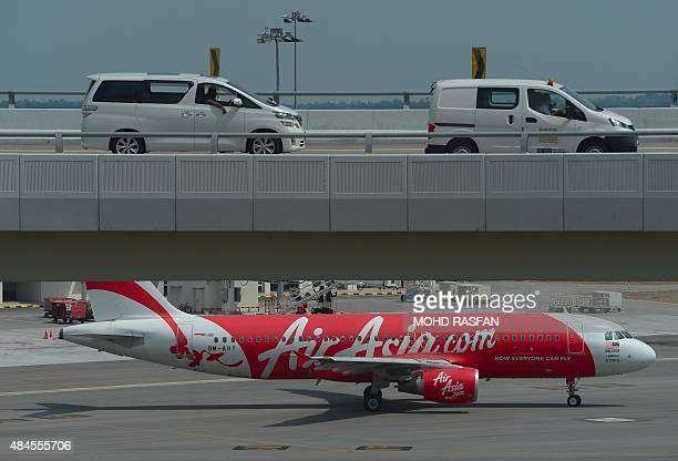 An AirAsia Airbus A320 airplane is seen on the tarmac preparing for departure at the lowcost carrier Kuala Lumpur International Airport 2 in Sepang...