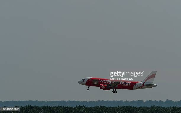 An AirAsia Airbus A320 airplane makes its final approach for landing at the lowcost carrier Kuala Lumpur International Airport 2 in sepang on August...