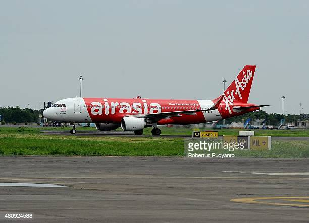 An AirAsia aircraft sits on the tarmac at Juanda International Airport on December 31 2014 in Surabaya Indonesia A massive recovery operation has...