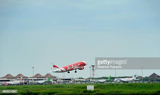 An AirAsia aircraft takes off at Juanda International Airport on December 31 2014 in Surabaya Indonesia A massive recovery operation has begun...