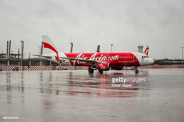 An AirAsia Airplane prepares for take of on a rainy day as bad weather slows down the search for victims of the AirAsia flight QZ8501 crash at...