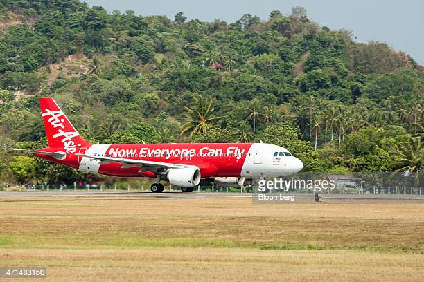 An AirAsia Bhd aircraft prepares to take off from Langkawi International Airport in Langkawi Malaysia on Wednesday March 18 2015 AirAsia Asia's...
