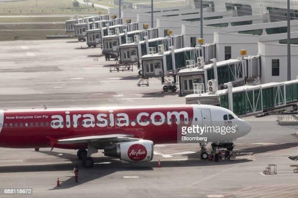 An AirAsia Bhd aircraft stands on the tarmac at Kuala Lumpur International Airport 2 in Sepang Selangor Malaysia on Thursday May 25 2017 AirAsia Bhd...