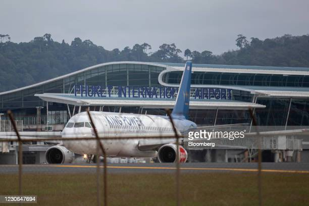 An AirAsia Group Bhd. Aircraft at Phuket International Airport in Phuket, Thailand, on Sunday, Dec. 20, 2020. The tepid response to Thailands highly...