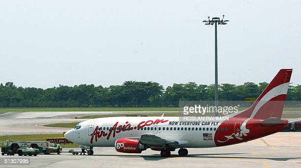 An AirAsia plane prepares for takes off at Singapore's Changi International Airport 15 September 2004 Thai AirAsia a joint venture between Malaysian...