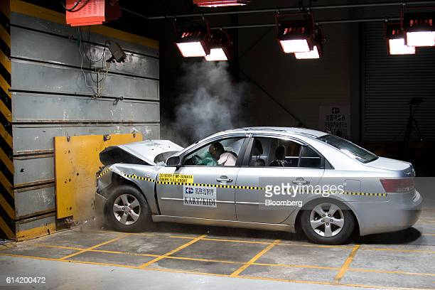 An airbag deflates after being deployed in front of a crash test dummy inside a Hyundai Motor Co NF Sonata vehicle during a headon crash test at 48...