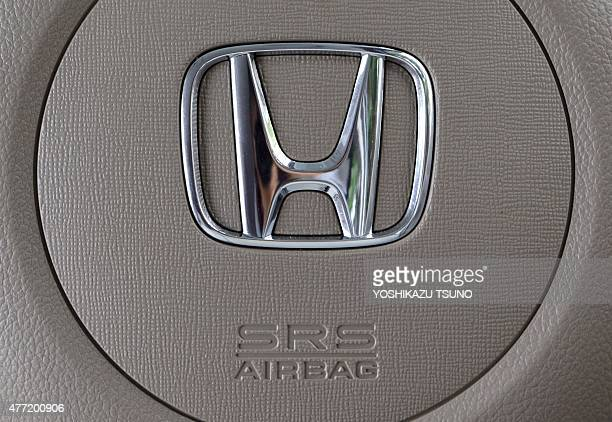 An airbag of a Honda vehicle is displayed in Tokyo on June 15 2015 Japanese automaker Honda has reported a new death linked to an exploding air bag...