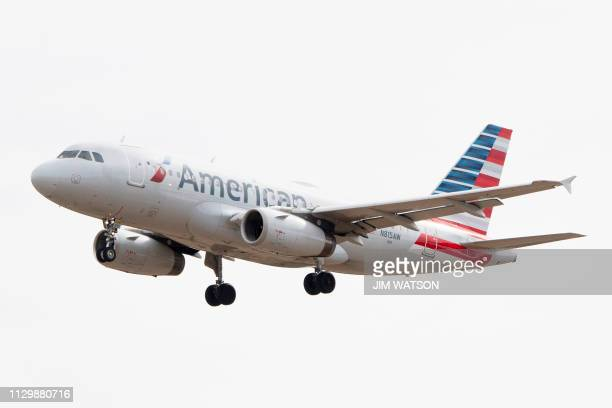 An Airbus 319 operated by American Airlines approaches for landing at Baltimore Washington International Airport near Baltimore Maryland on March 11...