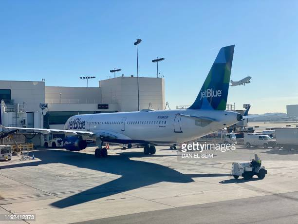 An Airbus 321 from the JetBlue airline company is seen at a gate at the Los Angeles International Airport on January 6 2020