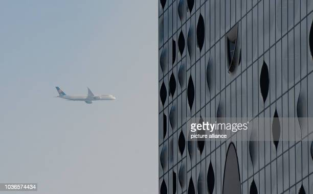 An Airbus 350900 flies over the Elbphilharmonie building in Hamburg Germany 09 February 2017 The newest aircraft model in the world was in the...