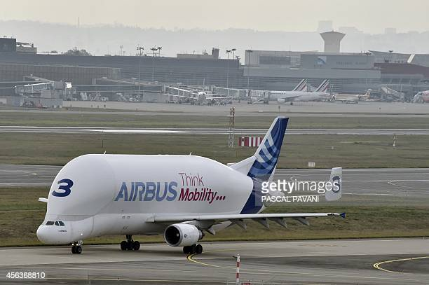 An Airbus A300600ST 'Beluga' aircraft maneuvers on the tarmac at the ToulouseBlagnac airport on September 29 2014 AFP PHOTO / PASCAL PAVANI