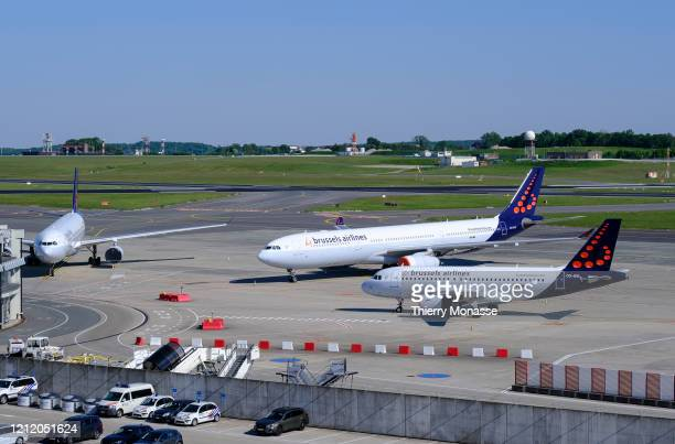 An Airbus A319 00SSL an Airbus A330 00SFC and another airliner from Brussels airlines are grounded in Zaventem airport on May 6 in Brussels Airport...