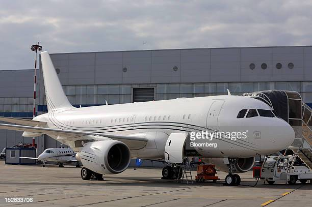 An Airbus A319 aircraft produced by Airbus SAS sits on the tarmac at the Jet Expo 2012 exhibition at Vnukovo airport in Moscow Russia on Thursday...