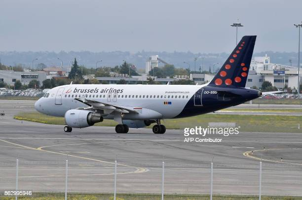 An Airbus A319 of Brussels Airlines is seen on the tarmac of the ToulouseBlagnac airport near Toulouse on October 19 2017 / AFP PHOTO / PASCAL PAVANI