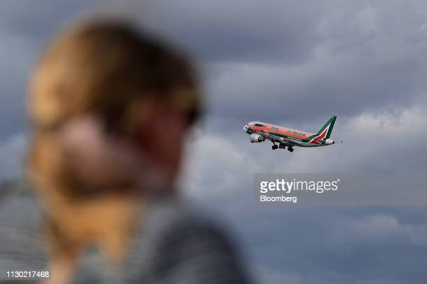 An Airbus A320 aircraft operated by Alitalia SpA flies from Tegel airport in Berlin Germany on Wednesday March 13 2019 Boeing Co staggered into a...