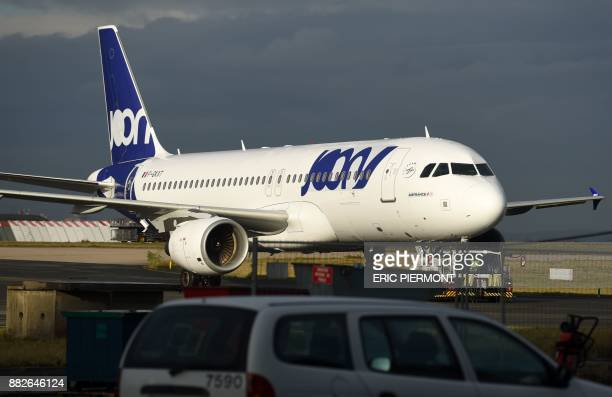 An Airbus A320 aircraft with the logo and colours of Joon the new lowercost airline subsidiary of Air France moves on the tarmac near Air France...
