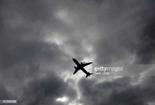 An Airbus A320 airplane takes off from a runway at Ronald Reagan Washington National Airport in Arlington Virginia September 23 2013 AFP PHOTO / Saul...