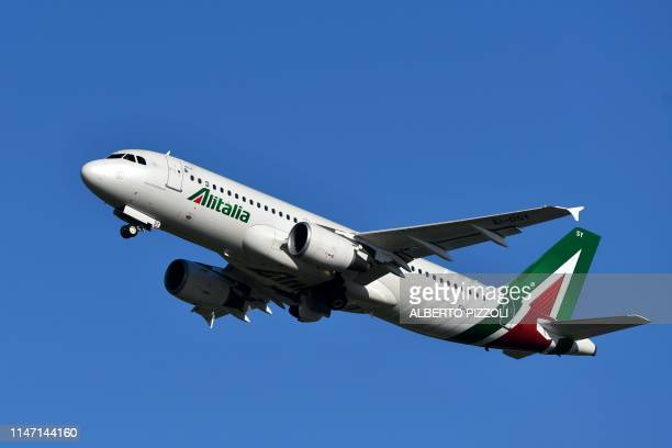 An Airbus A320 bearing the livery of Alitalia airline takes off from Rome's Fiumicino airport on May 31 2019
