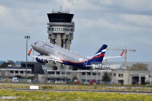 An Airbus A320 belonging to the Russian company Aeroflot takes off on September 26 2017 from ToulouseBlagnac airport in southwestern France / AFP...