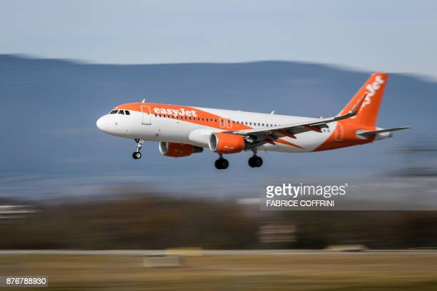 An Airbus A320 commercial plane of lowcost carrier EasyJet is seen landing at Geneva Airport on November 20 2017 in Geneva / AFP PHOTO / Fabrice...