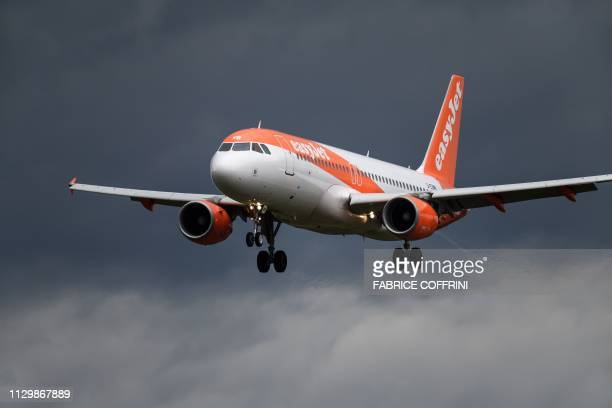 An Airbus A320 commercial plane with registration GEZTH of lowcost carrier EasyJet is seen landing at Geneva Airport on March 11 2019 in Geneva