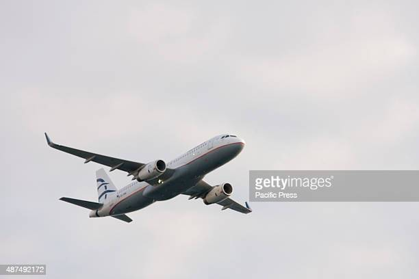 An Airbus A320 of Aegean airlines passes over the spectators during the preshow for the Athens Flying Week airshow at the Palaio Faliro