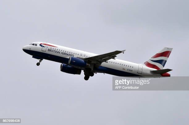 An Airbus A320 of British Airways airline flies after taking off from the ToulouseBlagnac airport near Toulouse on October 19 2017 / AFP PHOTO /...