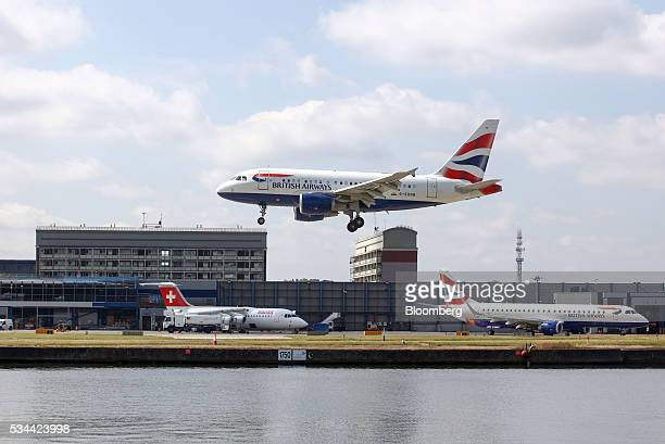 An Airbus A320 passenger aircraft operated British Airways a unit of International Consolidated Airlines Group SA prepares to land against a backdrop...