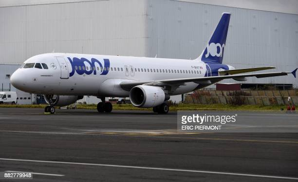 An Airbus A320 wearing the color of Joon the new airline subsidiary of Air France is parked on the tarmac of the Air France Industries maintenance...